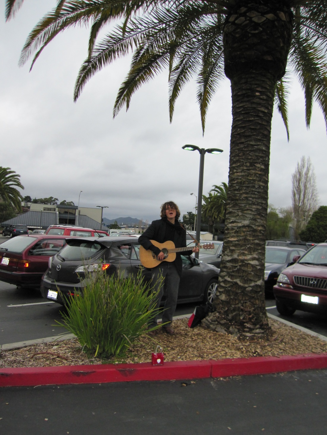 Dude Playing Guitar and Singing Outside Mollie Stone's in Sausalito, by Kelley Eling, Marin County Realtor